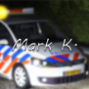 47e574 mark k. modding logo