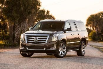 Dcec16 2015 cadillac escalade front three quarter